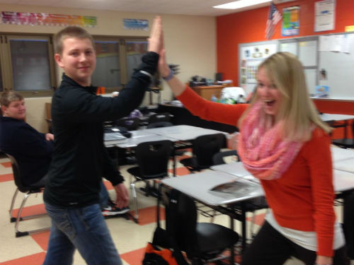 Student gets a High 5 from Mrs. Helman