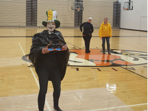 MRS HARTINGS THOROUGHLY PROTECTS HERSELF FROM A PIE IN THE FACE
