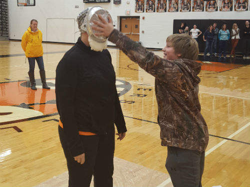 AND THERE IT GOES AND PIE DIRECTLY IN THE FACE OF MRS. BUSCHUR
