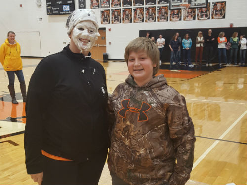 PI DAY ASSEMBLY - MRS. BUSCHUR TAKES A PIE IN THE FACE FROM ONE OF HER STUDENTS