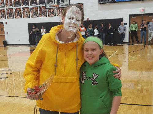 MRS GOUBEAUX GETS A PIE IN THE FACE FROM A STUDENT FOR PI DAY ASSEMBLY
