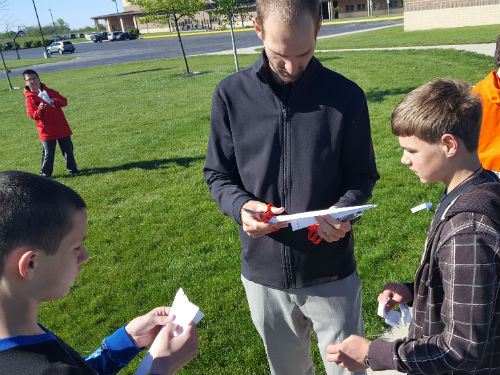 MR LUEBKE EXPLAINING MANIPULATIONS TO PAPER AIRPLANE FLIGHT