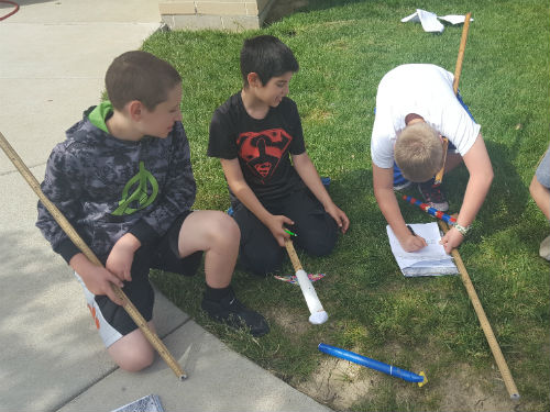 STUDENTS WORKING TOGETHER FOR THEIR TEST ROCKETS