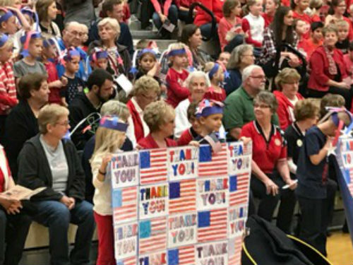 Veteran's Day Assembly - the students have lots of spirit