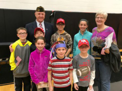 Veteran and his family of Versailles students