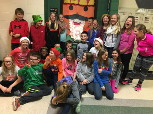 Students enjoying Christmas door decorating contest