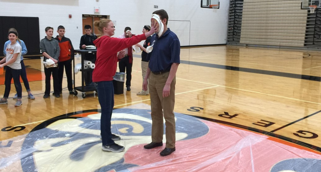 Mr. Keller gets a pie in the face for Pi-Day