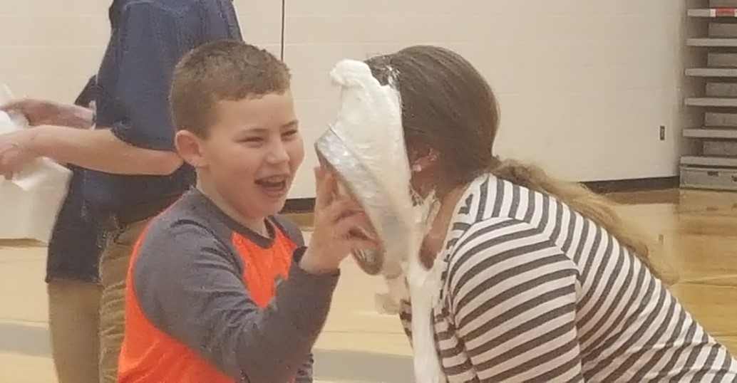 Mrs. Driver gets a pie in the face for Pi-Day