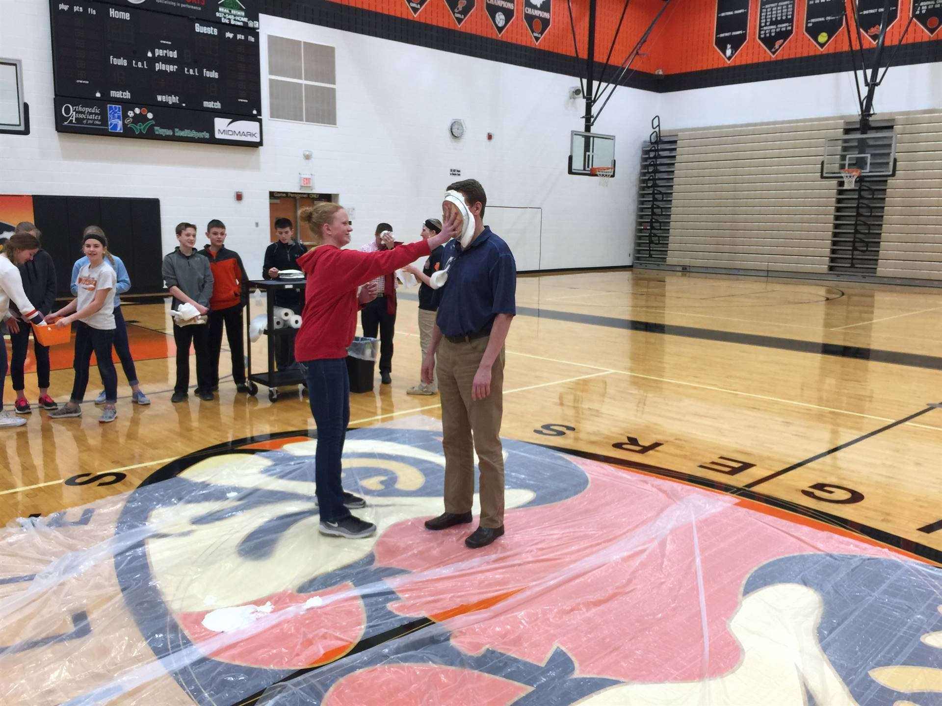 Mr. Keller gets a pie in the face
