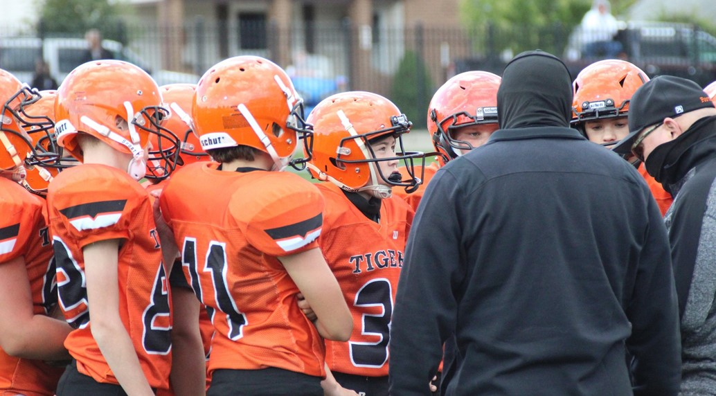 Jr. High football huddle