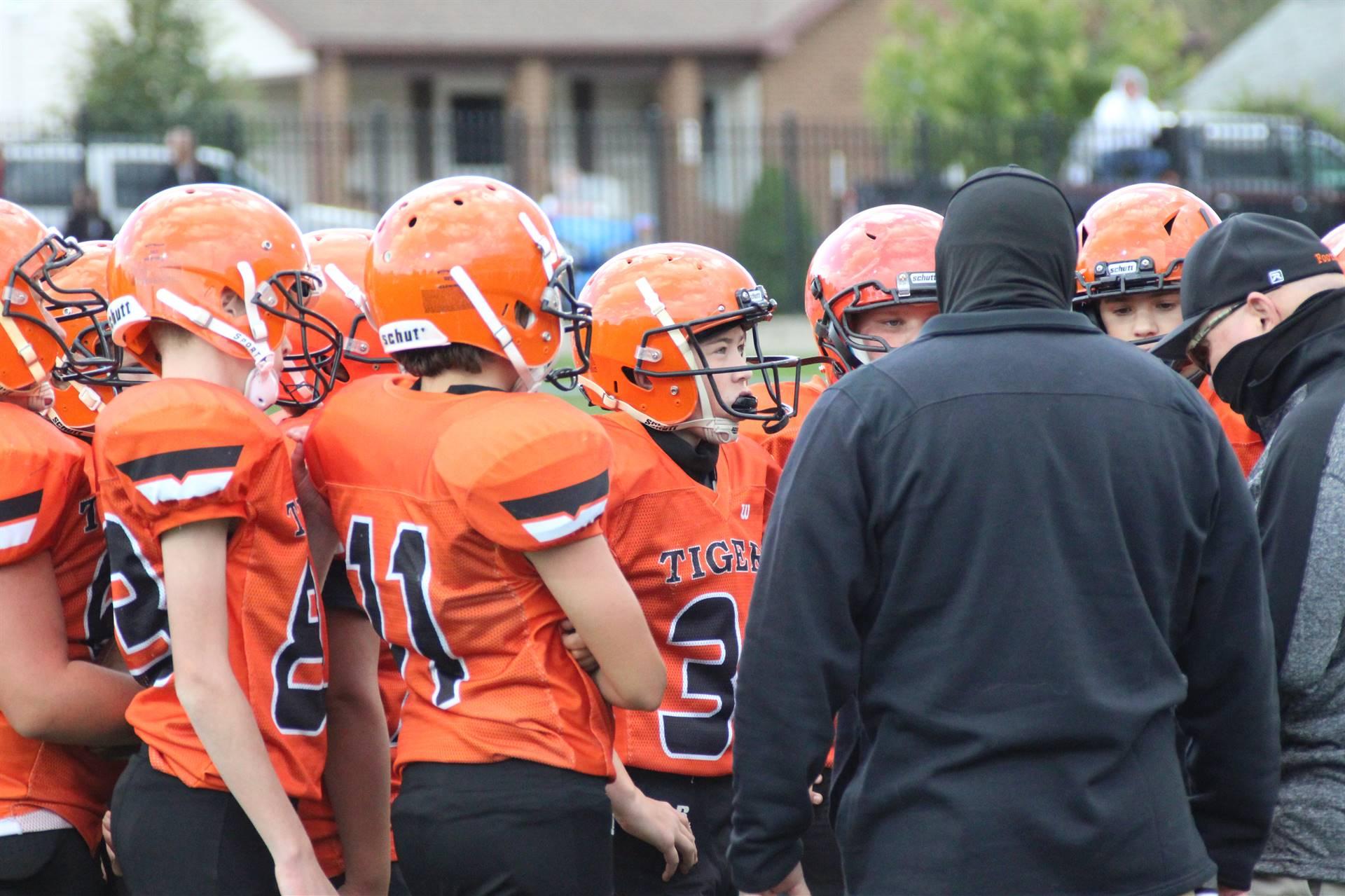 Jr High football huddle