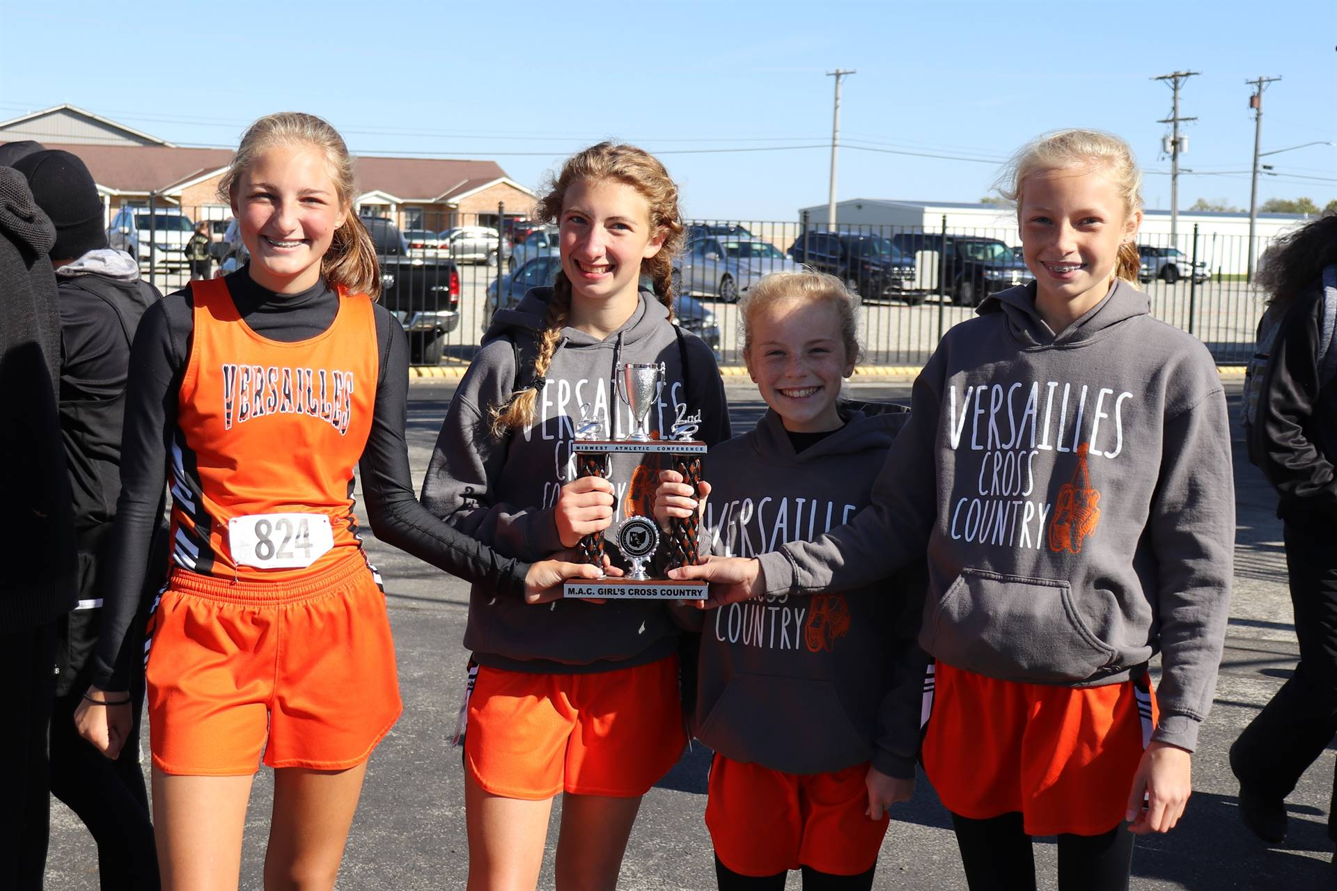 MAC junior high cross country show their trophy